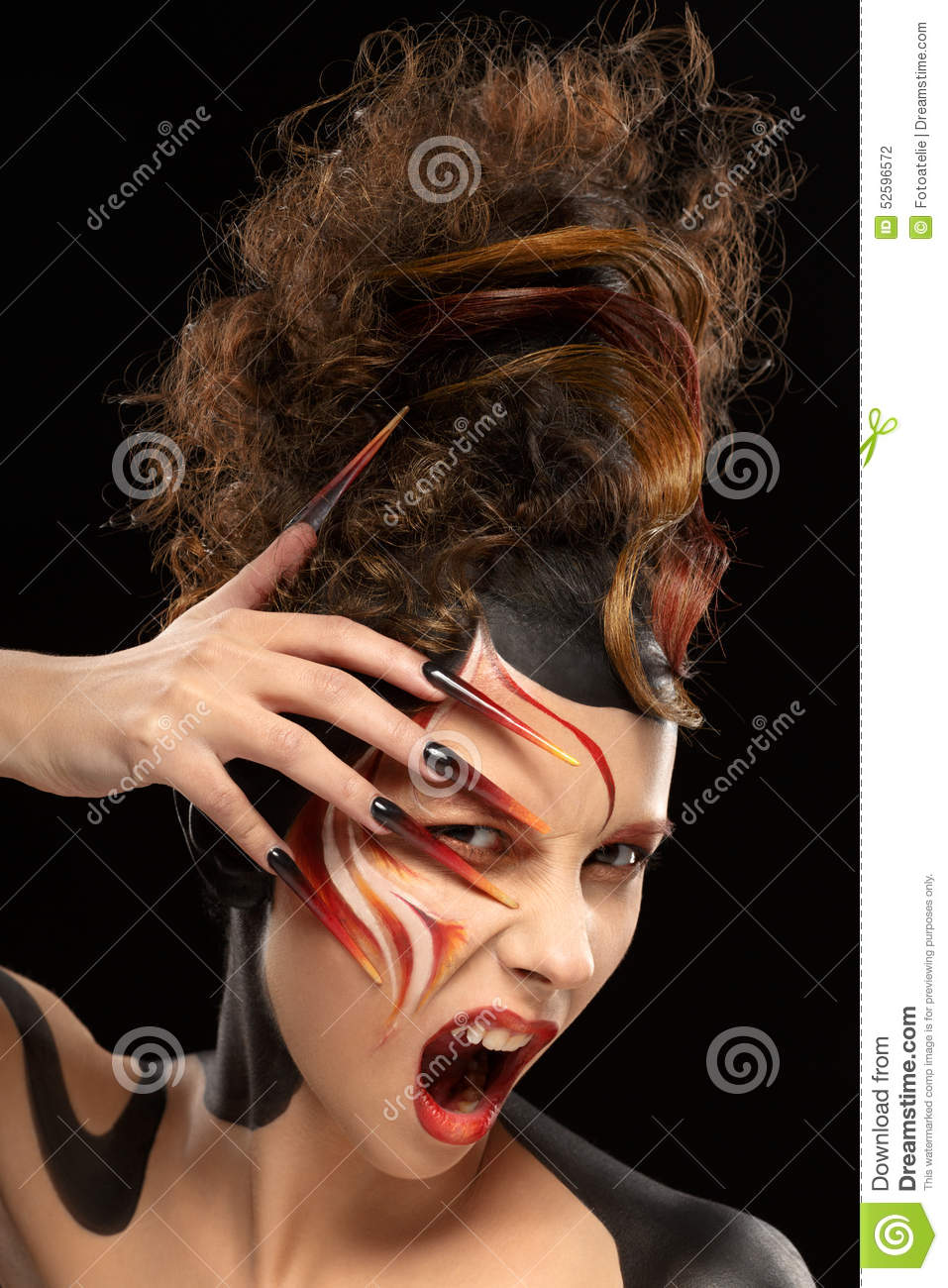 Beautiful fashion woman color face art fenix style and nail design