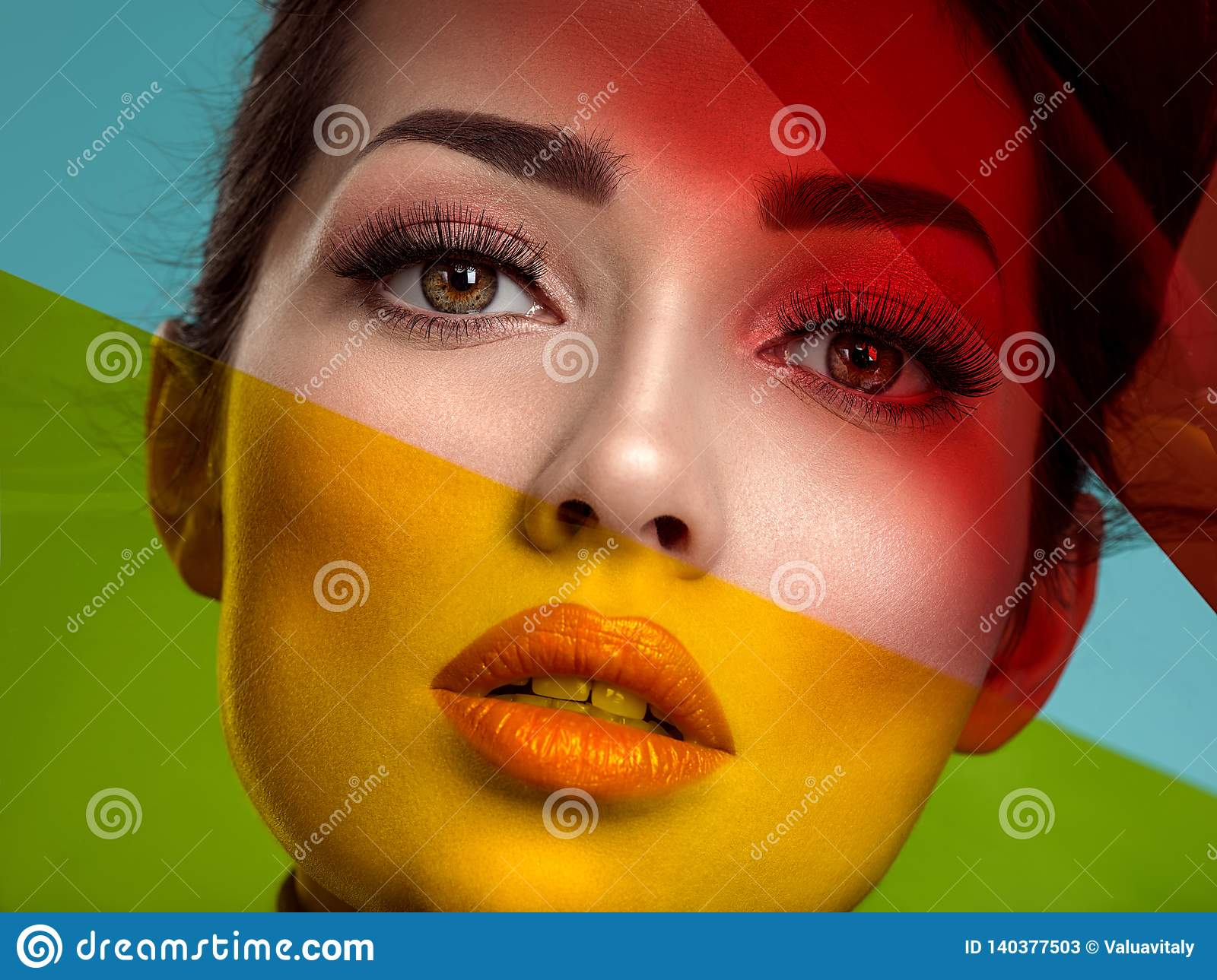 Beautiful fashion woman with a colored items. Attractive white girl with living coral makeup