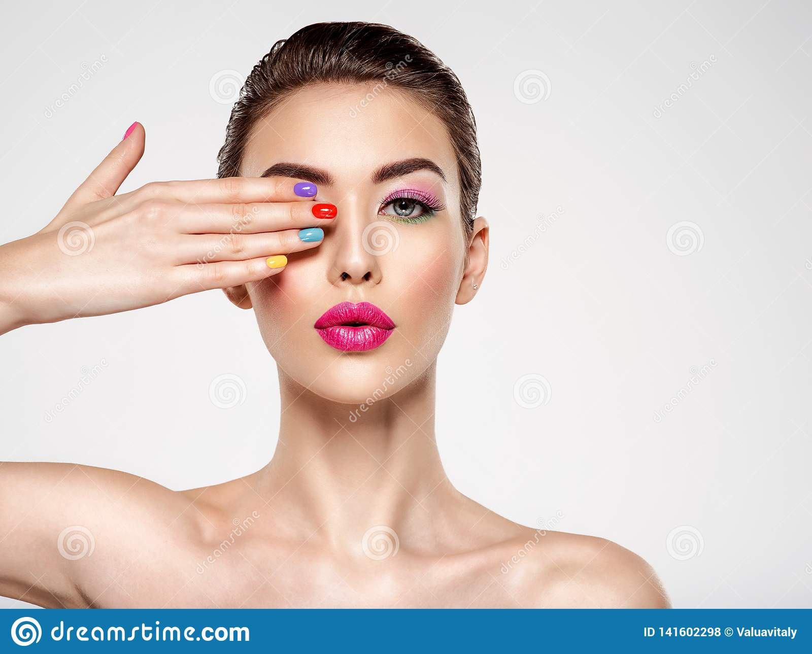 Beautiful fashion woman with a colored nails. Attractive white girl with multicolor manicure
