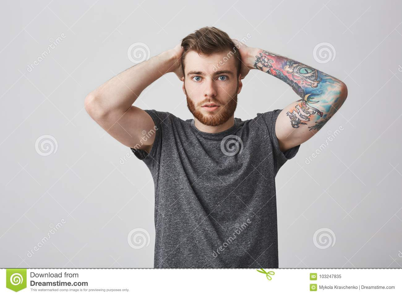 Beautiful Fashionable Bearded Men With Colored Tattoo On Arm And
