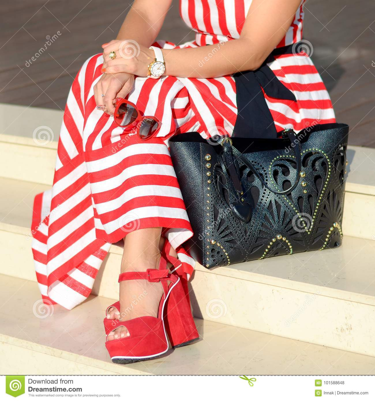 Beautiful fashionable shoes on women`s leg. Stylish ladies accessories. red  shoes fb04972c3c