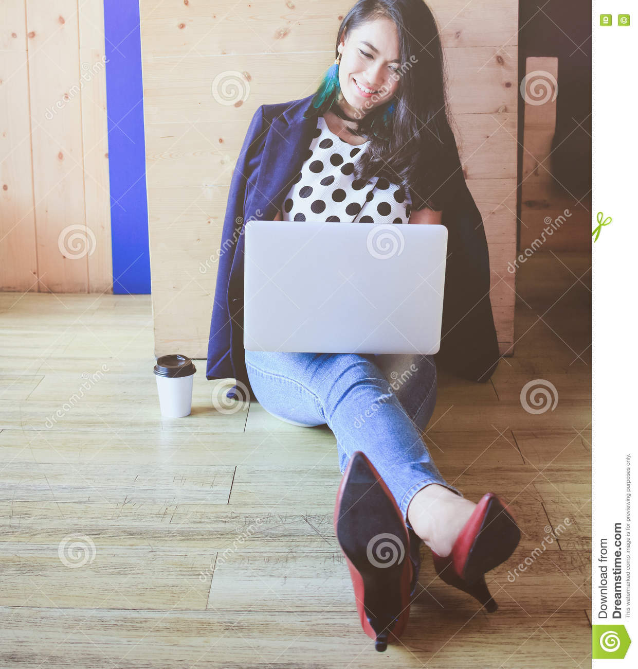 Beautiful fashionable woman working with laptop