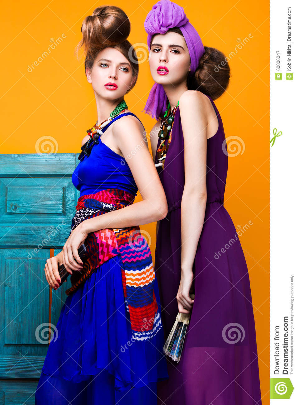 Beautiful Fashionable Women An Unusual Hairstyle In Bright Clothes