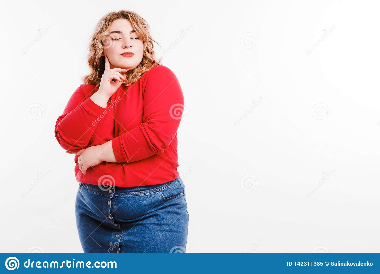 Beautiful fat young woman with bright emotions on a light gray background. Concept of diet. Space for text.