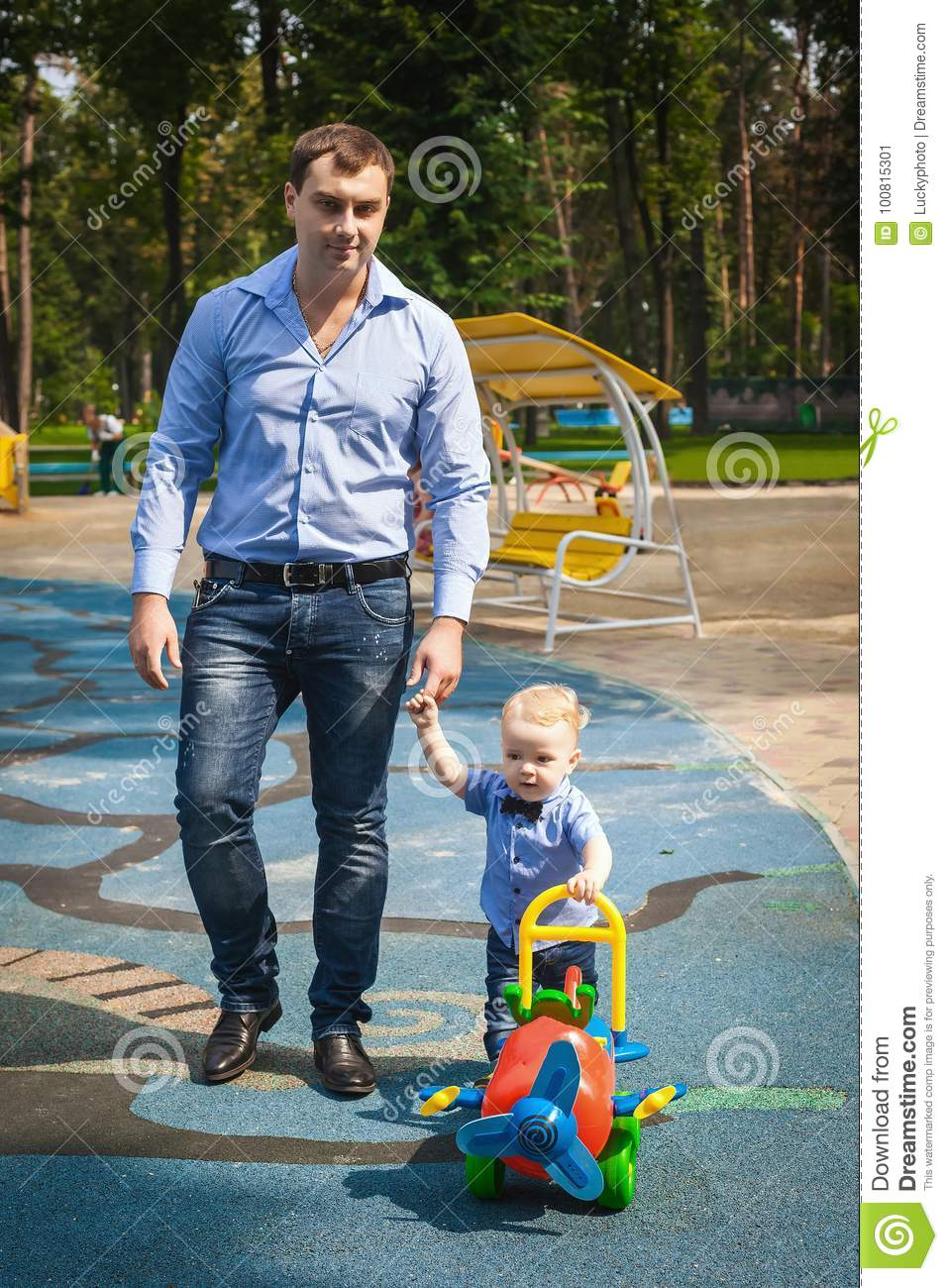 417594ca1 Beautiful Father And Son Walking In Garden Stock Image - Image of ...