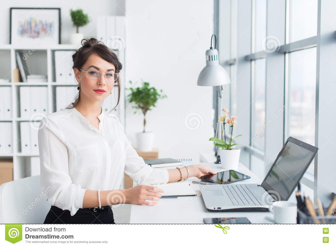 Young Female Office Worker Smiling In Office Royalty Free