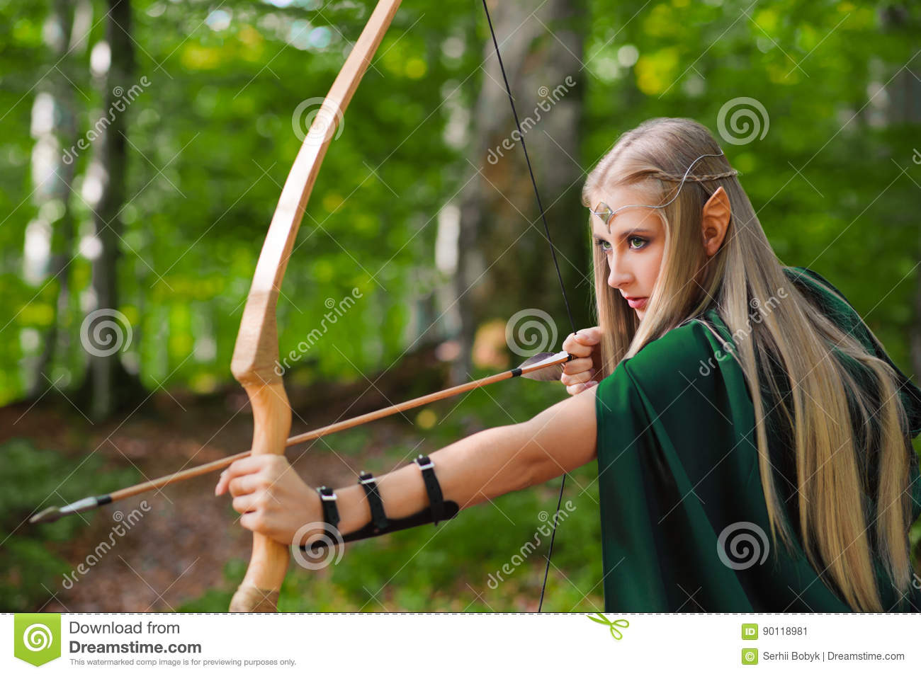 beautiful female elf archer in the forest hunting with a bow stock