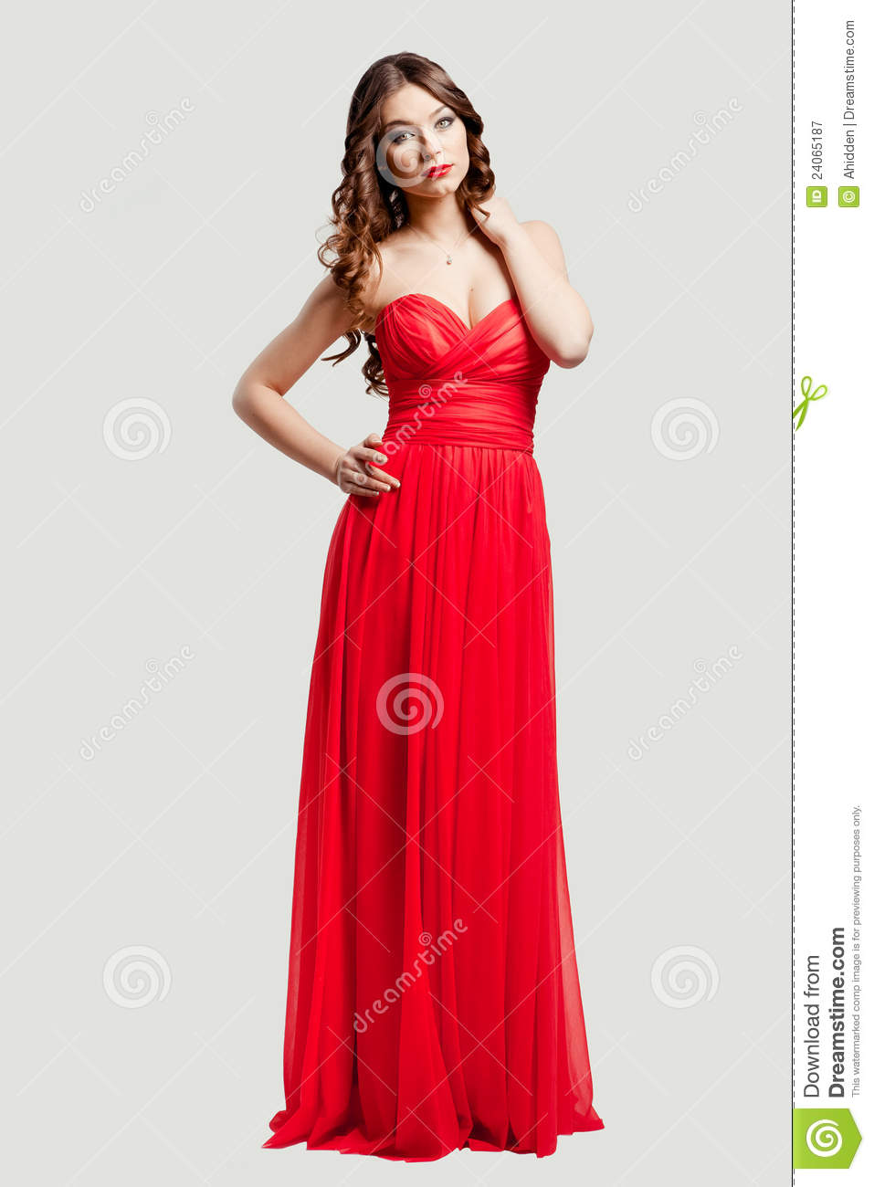 Beautiful Female Fashion Model In Red Dress Royalty Free