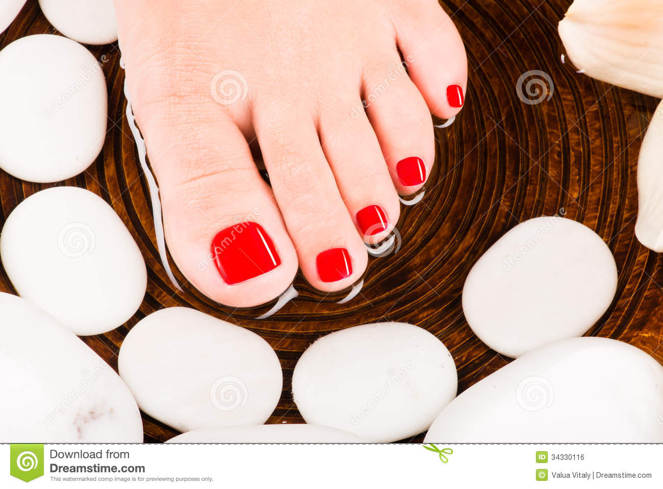 ... similar stock images of ` Beautiful female feet with red pedicure