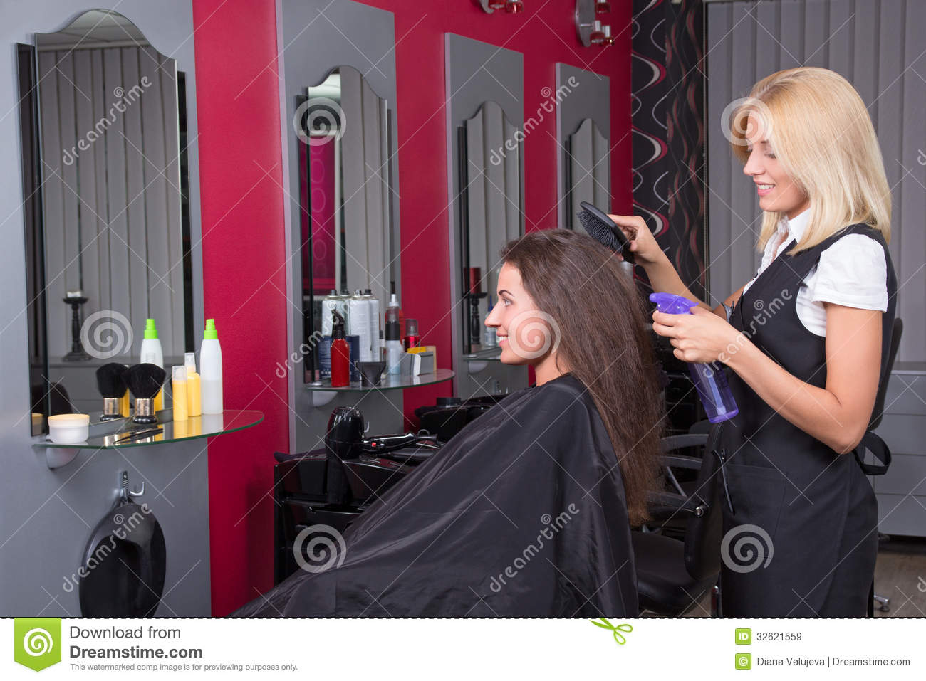 beautiful female hairdresser working in beauty salon royalty free stock images