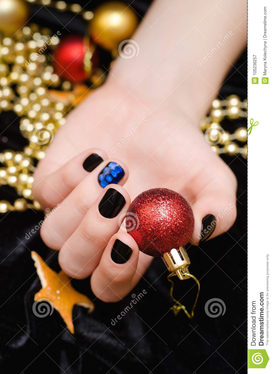 Beautiful Female Hand With Red And White Nail Design Christmas Nail Art