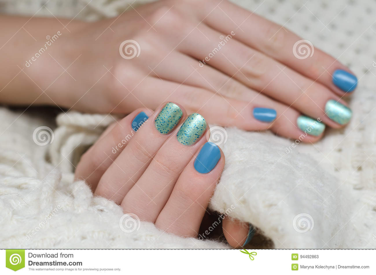 Beautiful Female Hand With Blue And Green Glitter Nail Design Stock
