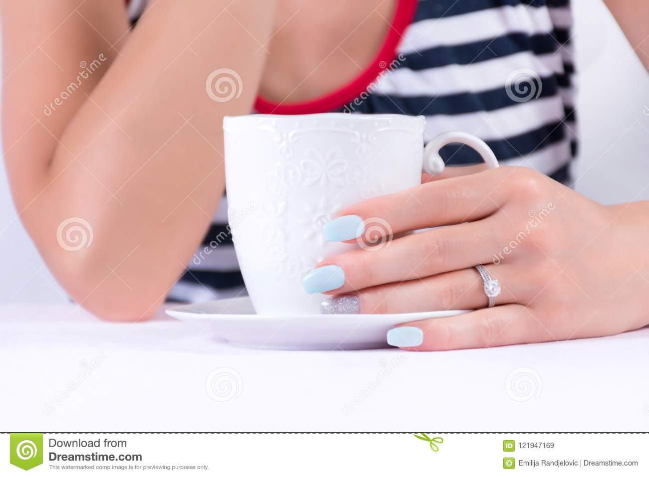 Beautiful Female Hand With Diamond Wedding Ring And Blue Nails ...