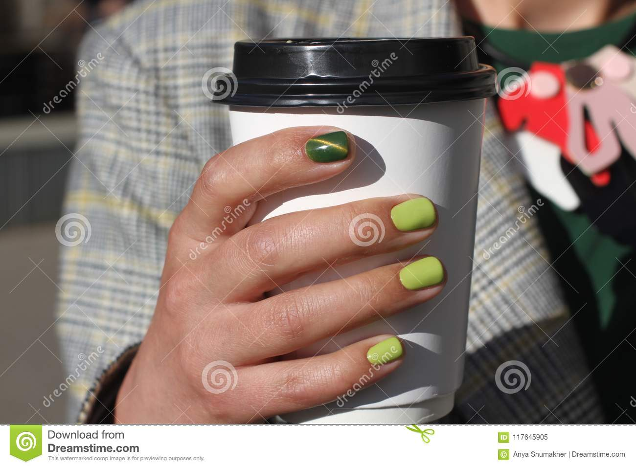 Beautiful Female Hand With Manicure Holds Cardboard Coffee Cup