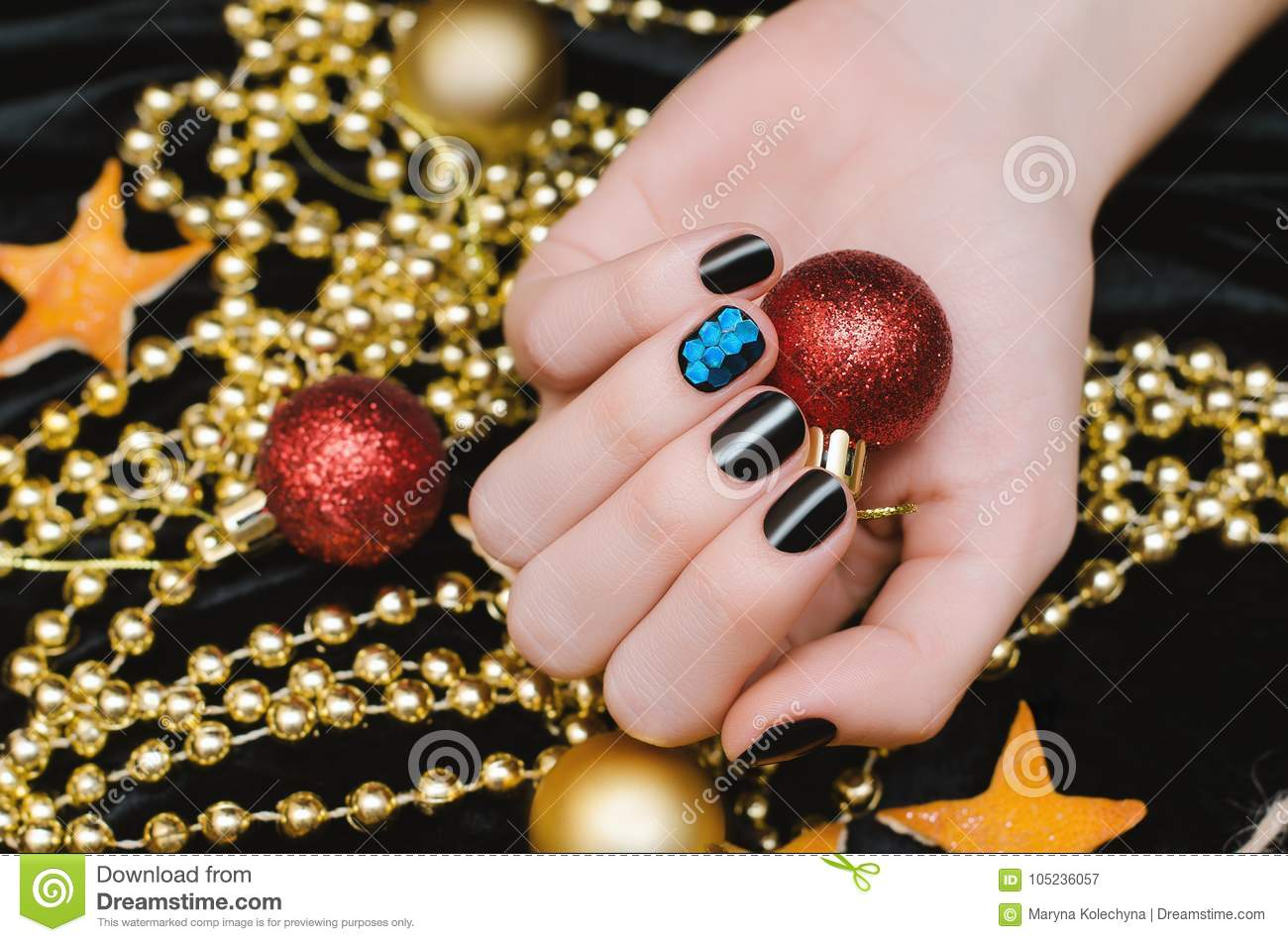 Beautiful Female Hand With Black And Blue Nail Design Christmas