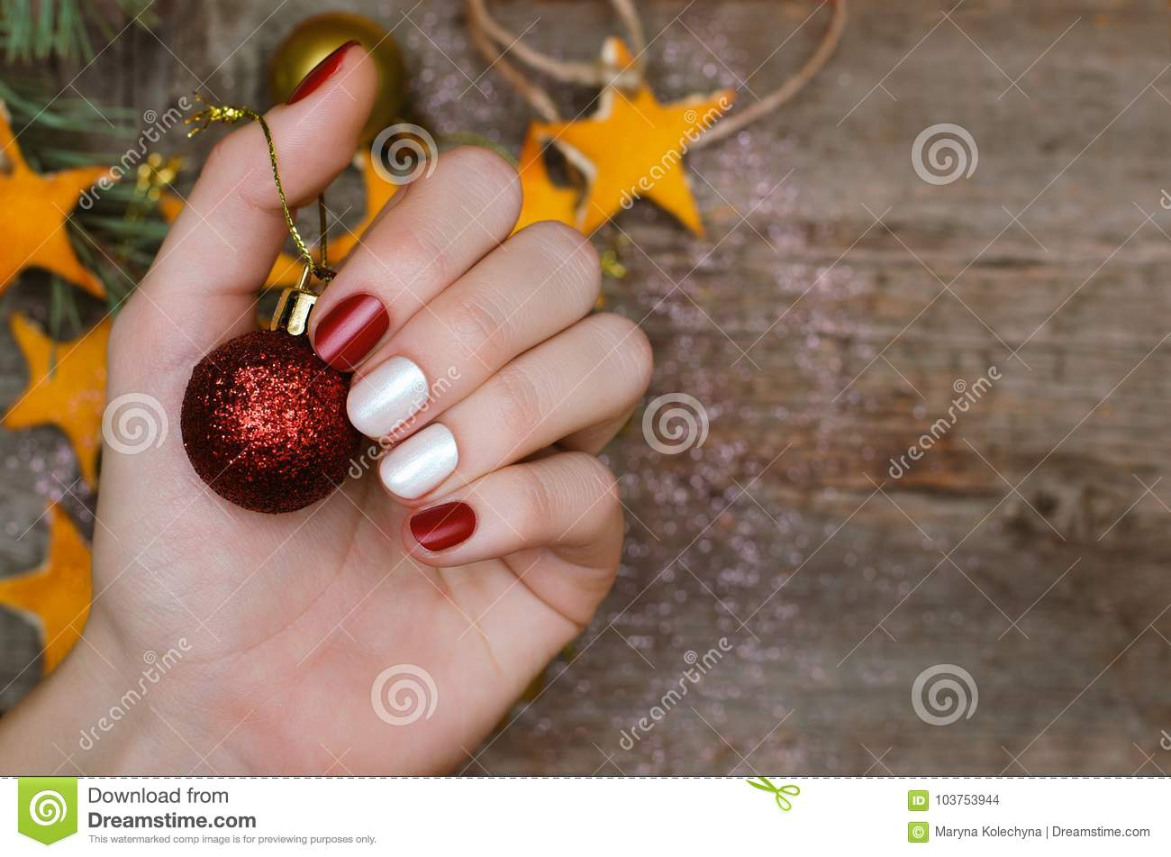 Beautiful Female Hand With Red And White Nail Design Christmas