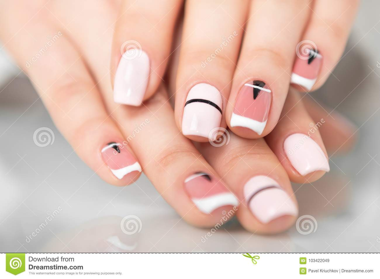 Beautiful Female Hands With A Fashionable Manicure Geometric Design