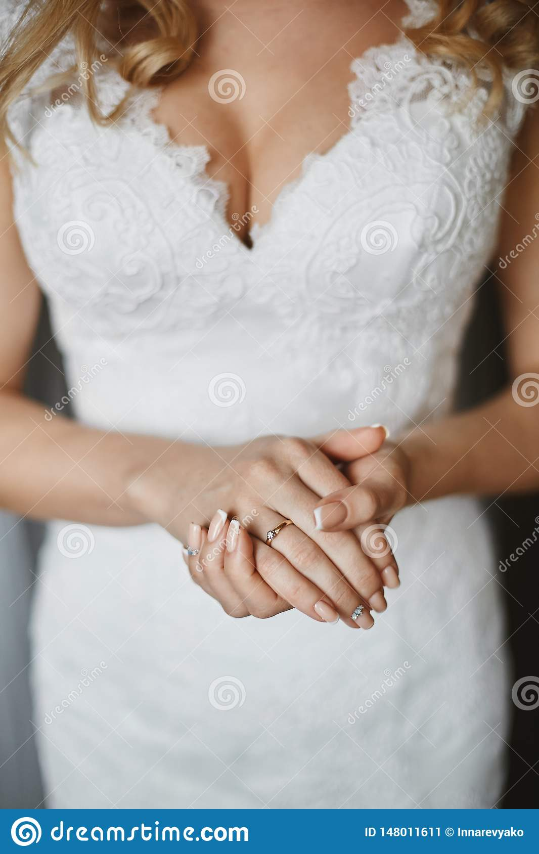 Beautiful Female Hands With The Wedding Ring And Elegant Manicure