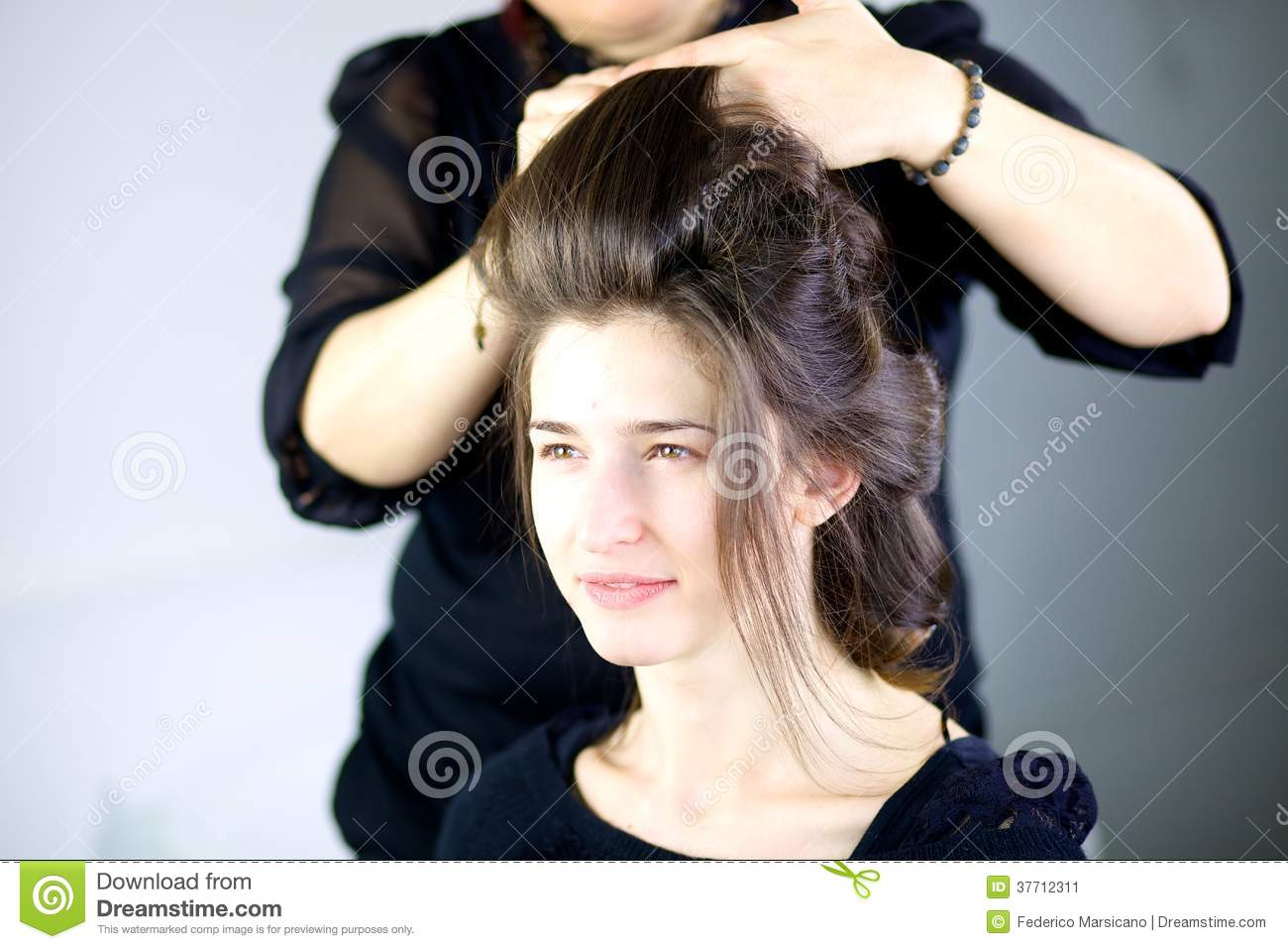 beautiful female model getting hair done by professional hairstylist - Professional Hairstylist