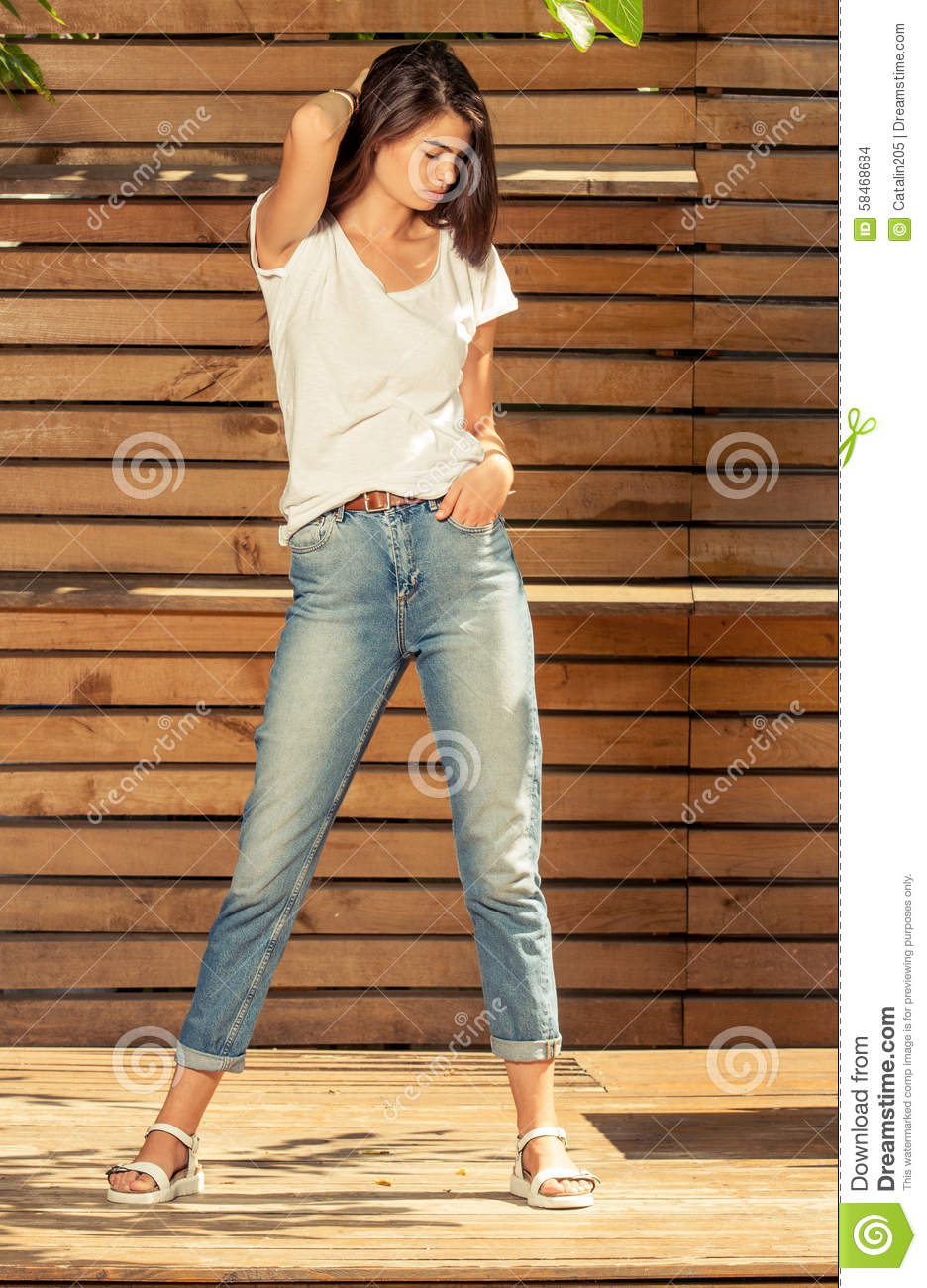 beautiful female model posing outdoor in a sunny day stock