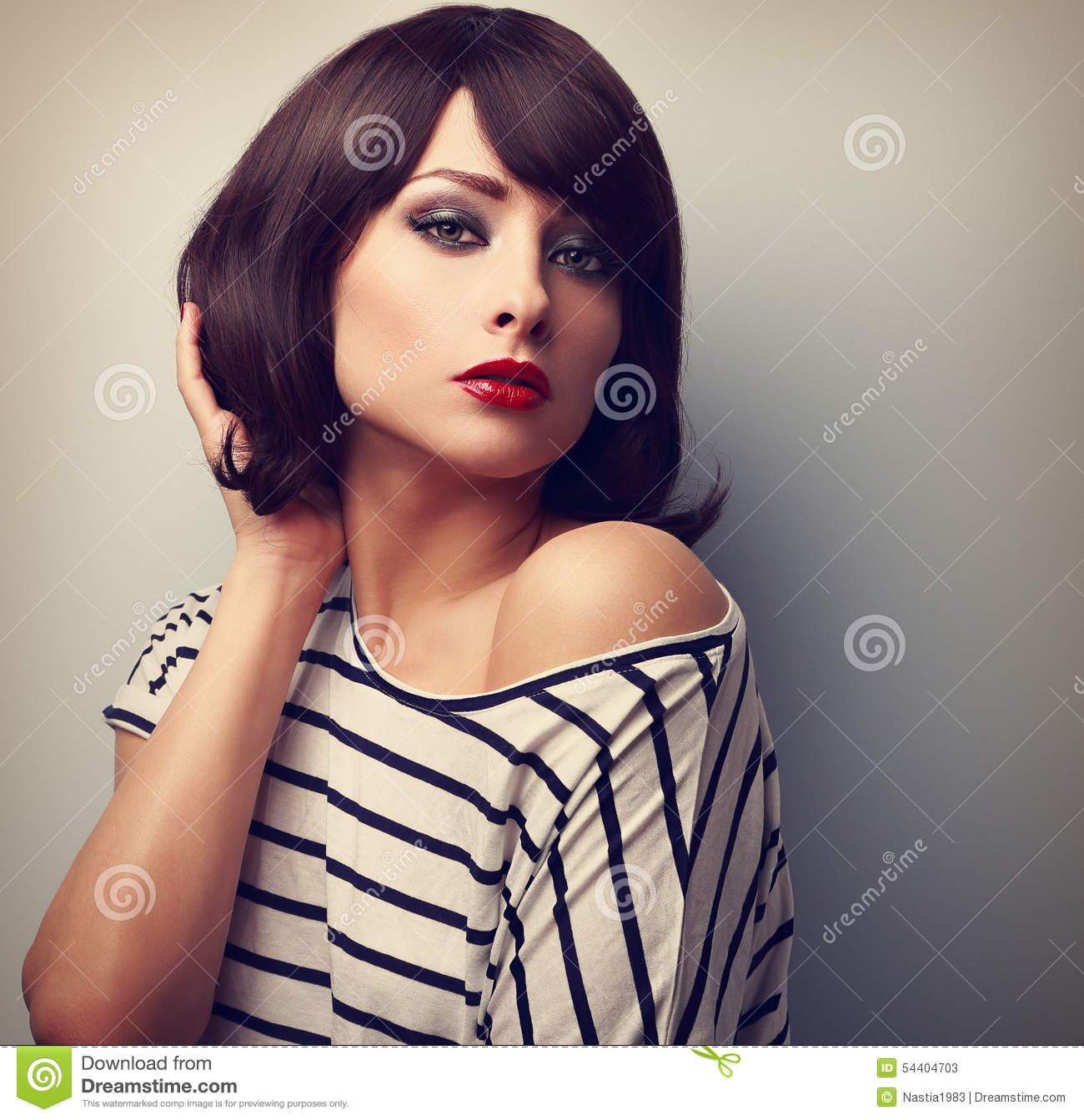 Beautiful Female Model With Short Hair Style In Casual