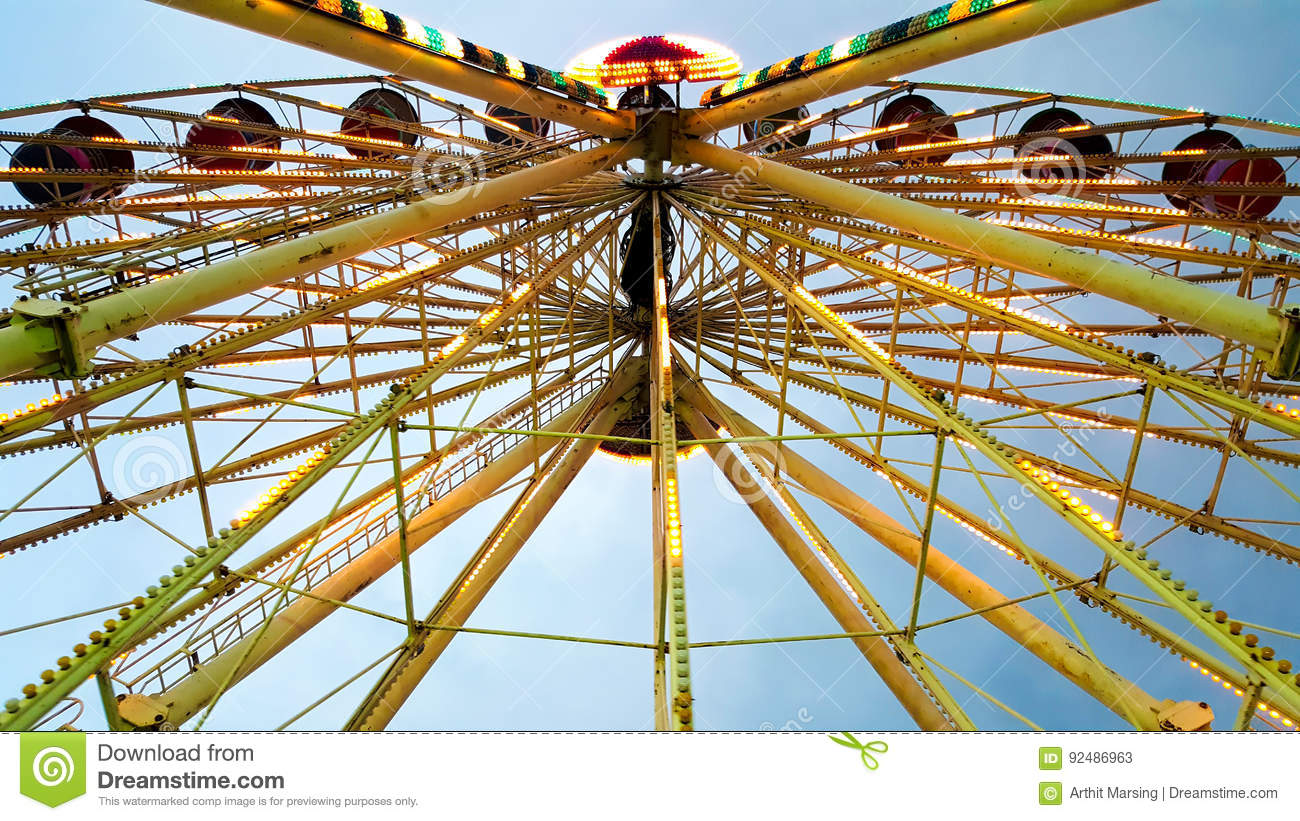 Beautiful Ferris Wheel decorate with colorful and beautiful lighting is rotating and shown in the movable festival carnival funfai