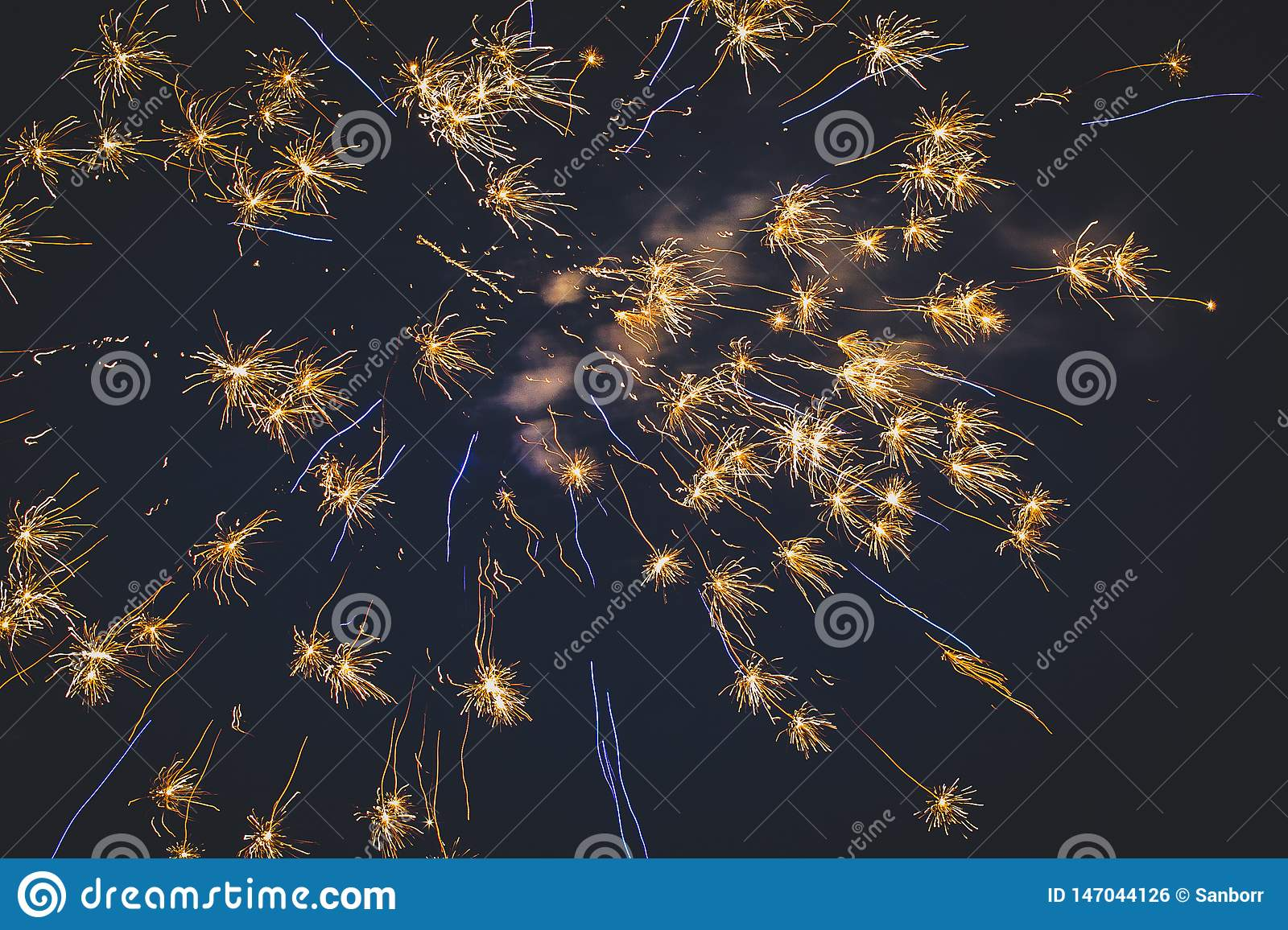 Beautiful fireworks in the night sky close-up. Bright explosion of festive fireworks on a dark background