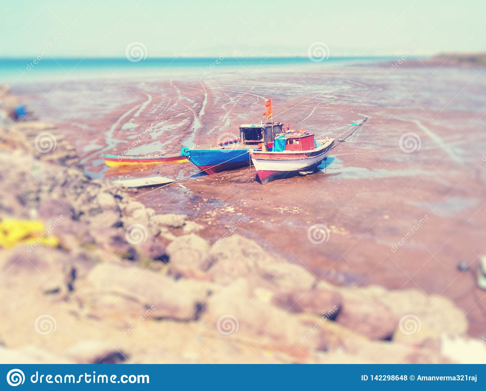 Two fishing boat on beach.