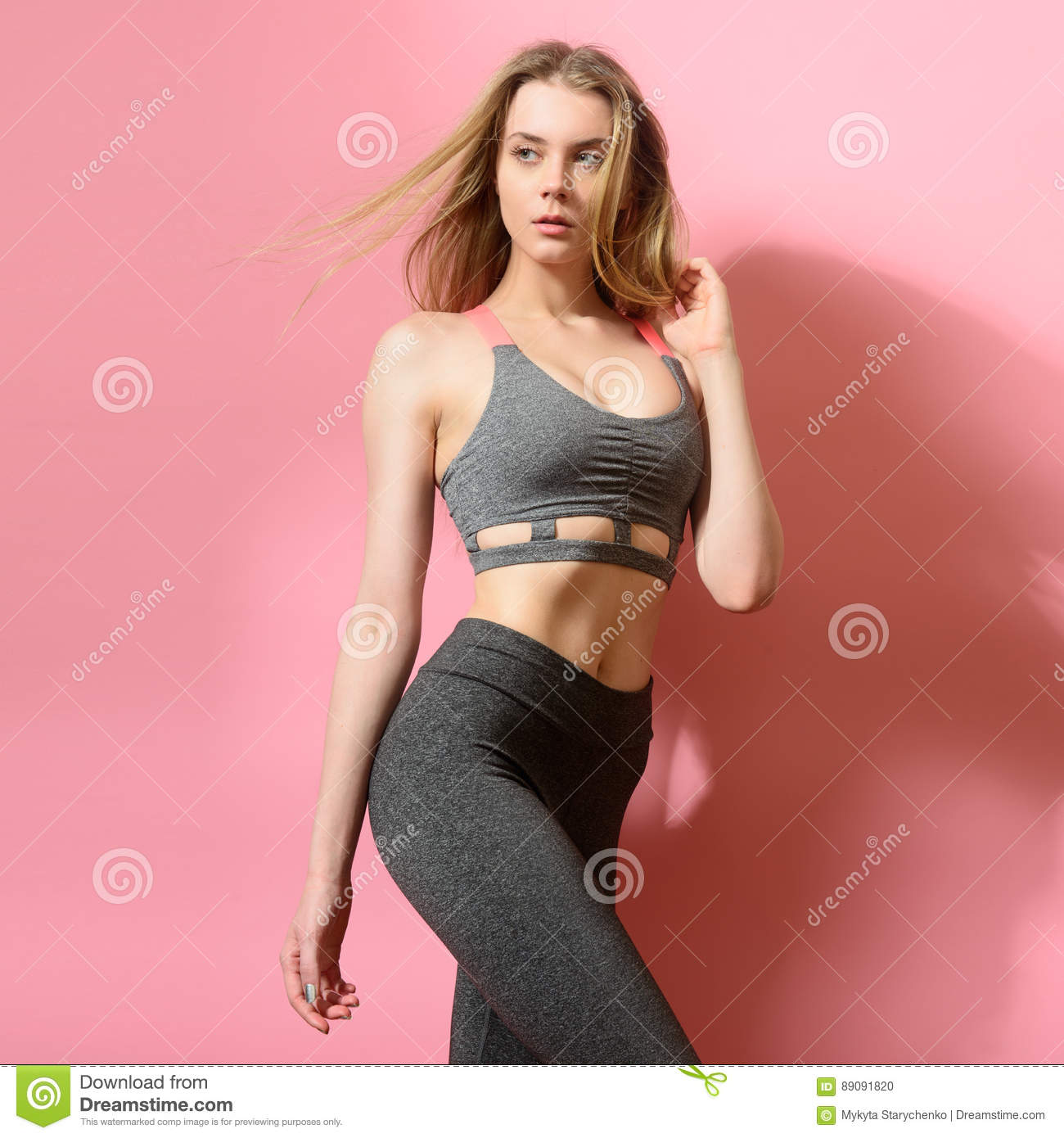 Beautiful fitness model girl posing wearing sport clothes.