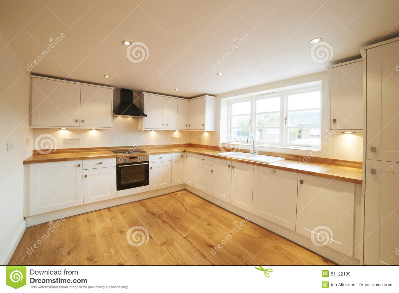 Beautiful fitted kitchen in modern home stock image for Modern fitted kitchen