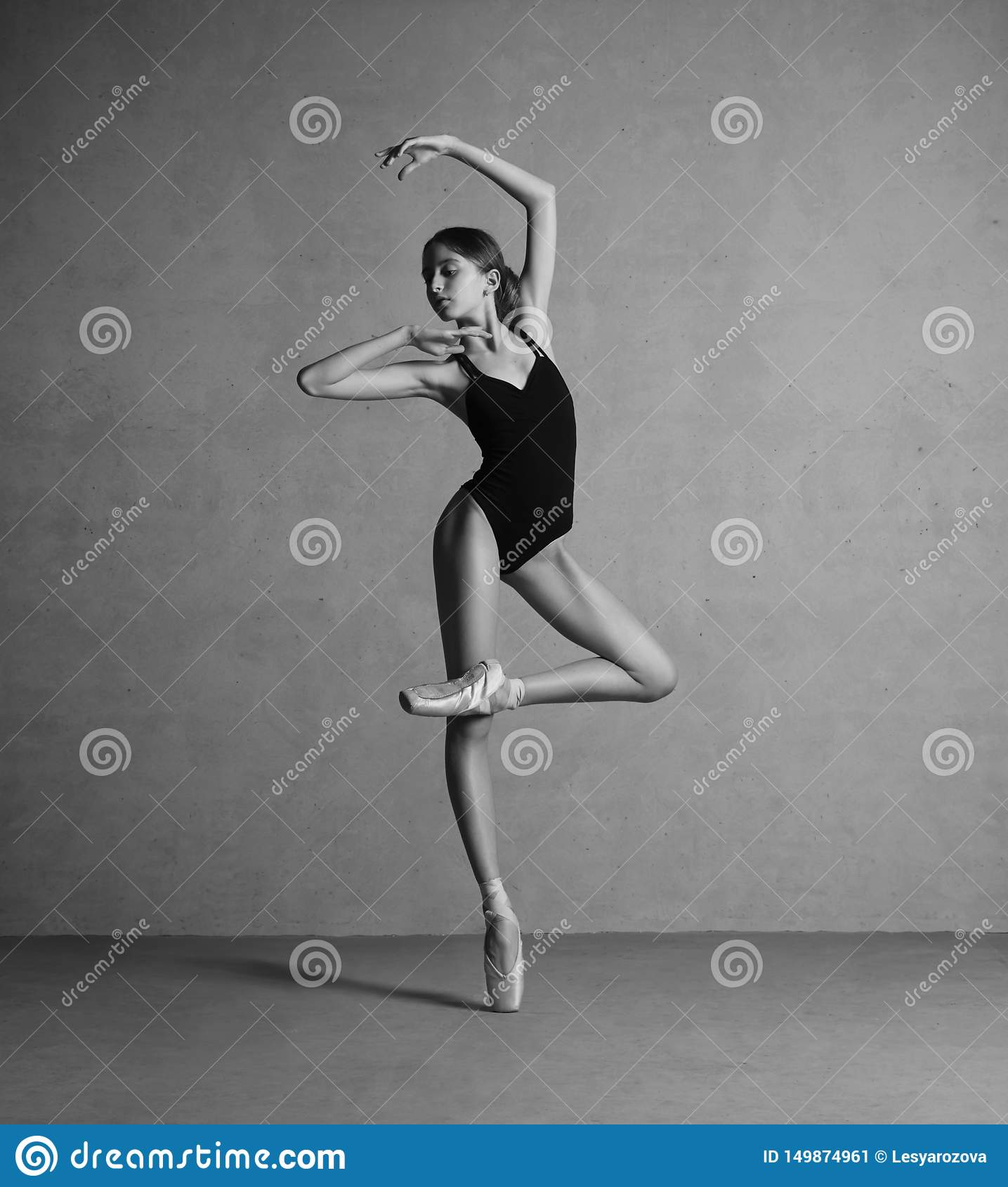 Flexible dancers legs performing in the white colored room