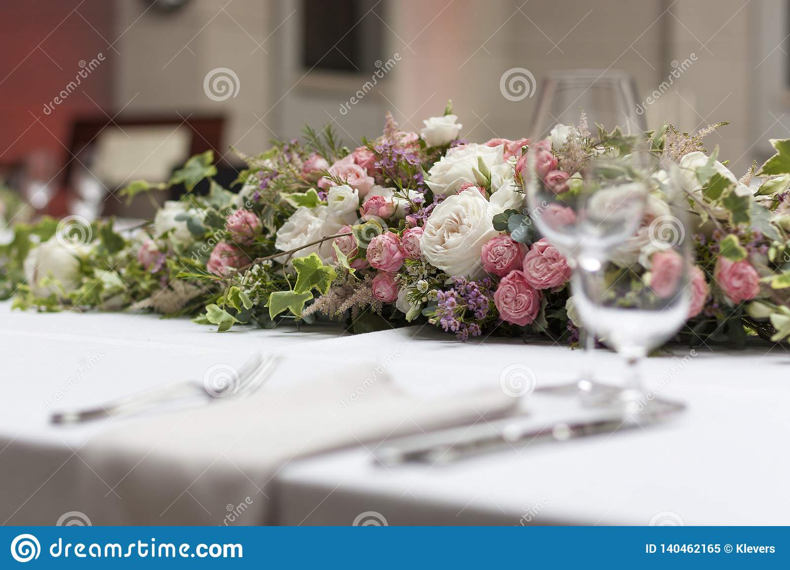Beautiful Floral Arrangement On The Table On The Wedding Day In The Restaurant Stock Image Image Of Action Arrangements 140462165