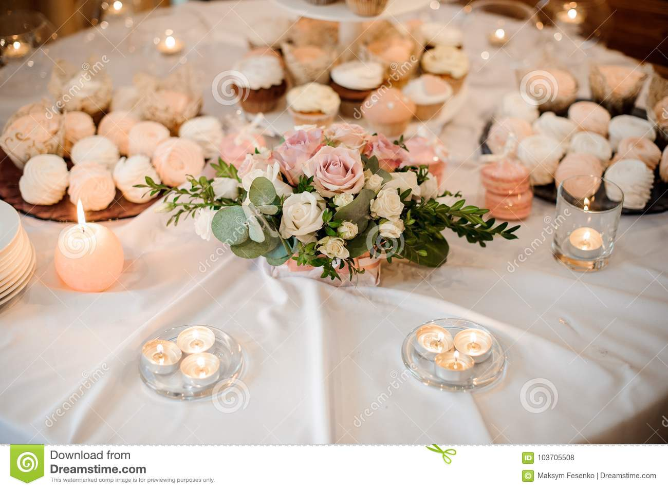 Beautiful Flower Composition And Candles Decorating A Festive Table