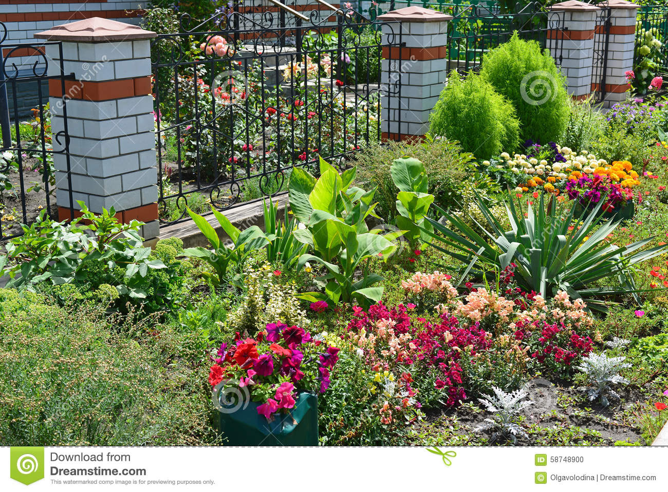 Beautiful flower garden in front of house stock photo for Garden in front of house