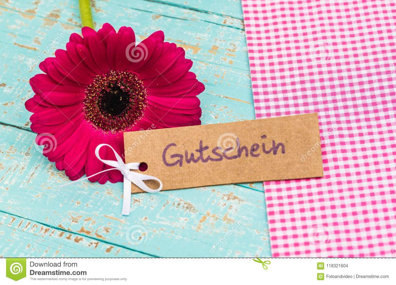 Beautiful flower with gift tag with german word gutschein means beautiful flower with gift tag with german word gutschein means voucher or coupon for izmirmasajfo