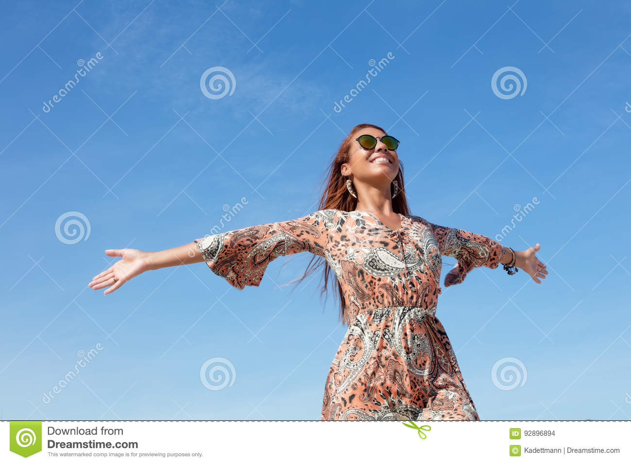 Beautiful flower power woman with copy space in blue sky outdoor