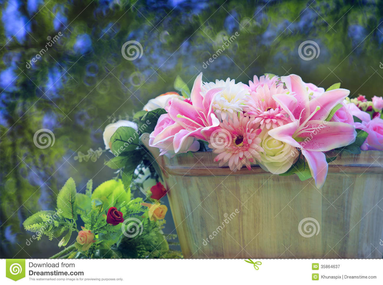 Beautiful flowers bouquet arranged in wood bucket with copy space beautiful flowers bouquet arranged in wood bucket with copy space and blur background use as multipurpose backdrop and beautiful izmirmasajfo