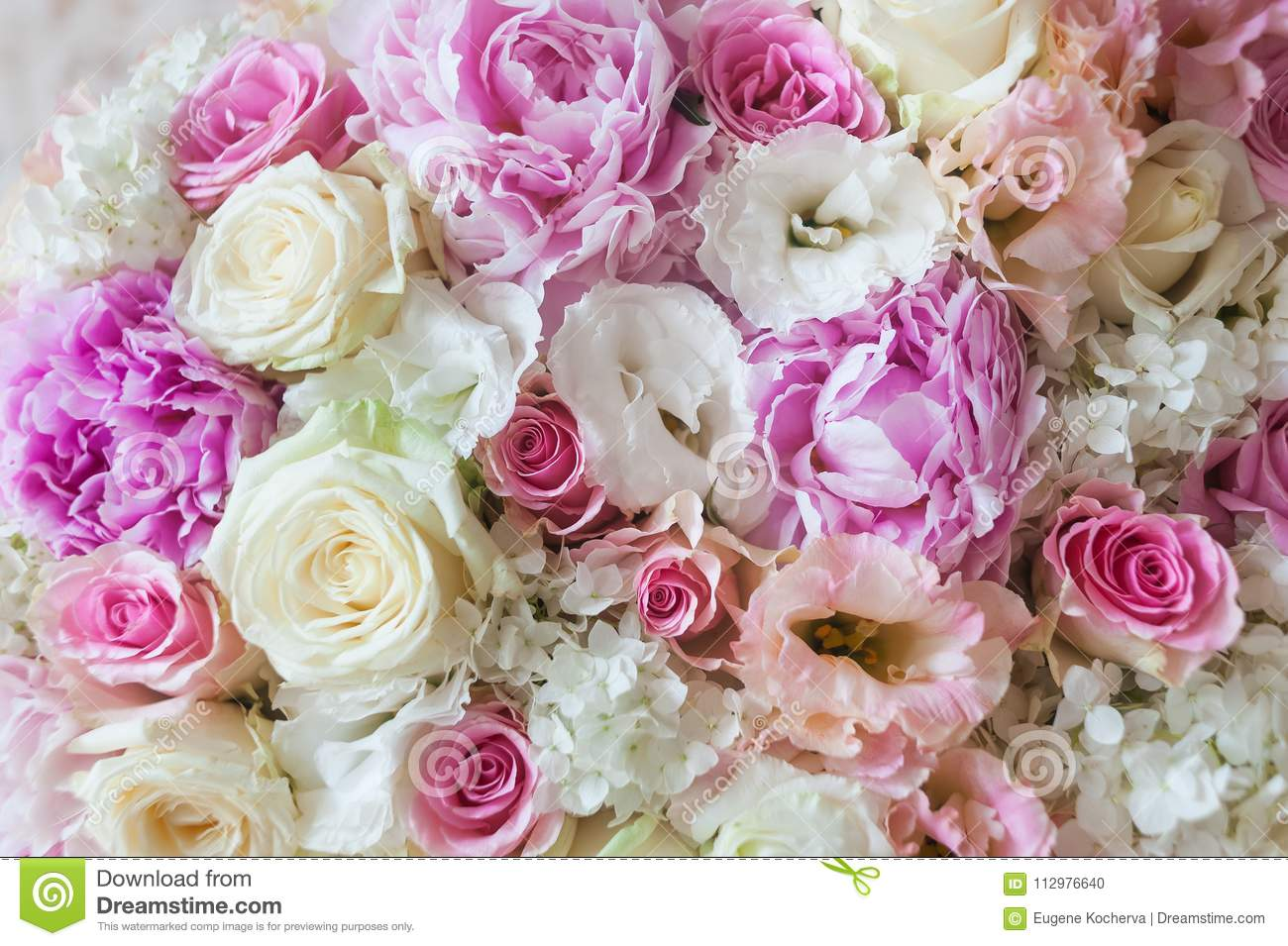 Beautiful flowers. A flower background from white roses, peonies, a falenopsisa, eustoma