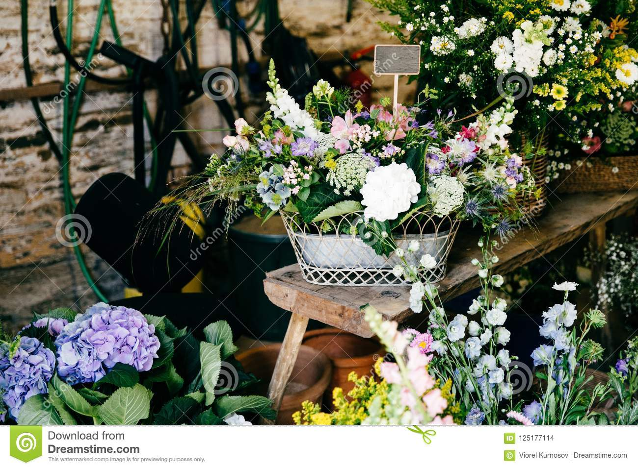 Beautiful flowers in flower shop different wonderful flowers in download beautiful flowers in flower shop different wonderful flowers in wooden backets colorful composition izmirmasajfo
