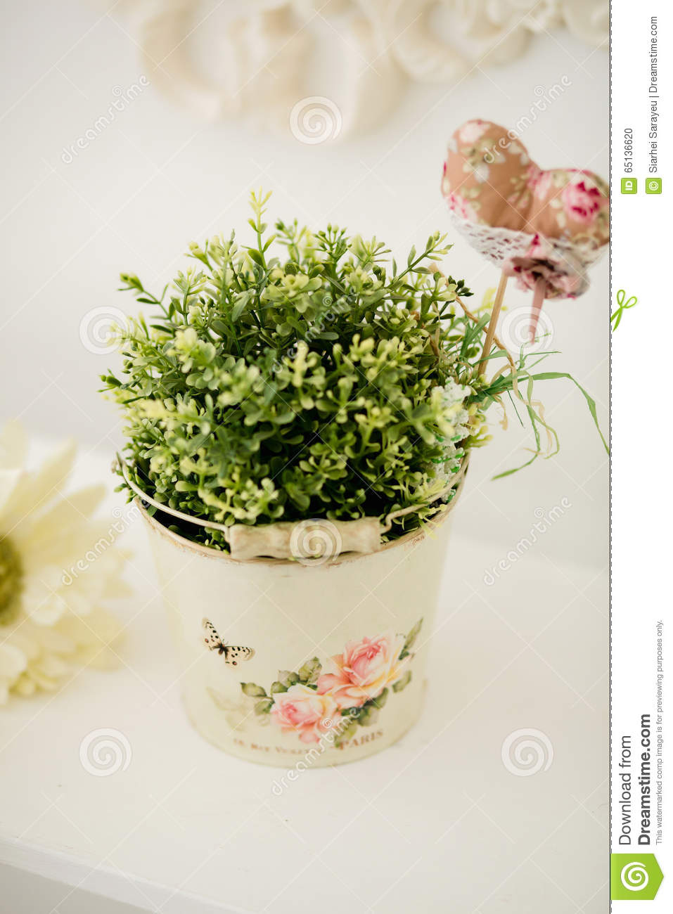Beautiful flowers in pail on table