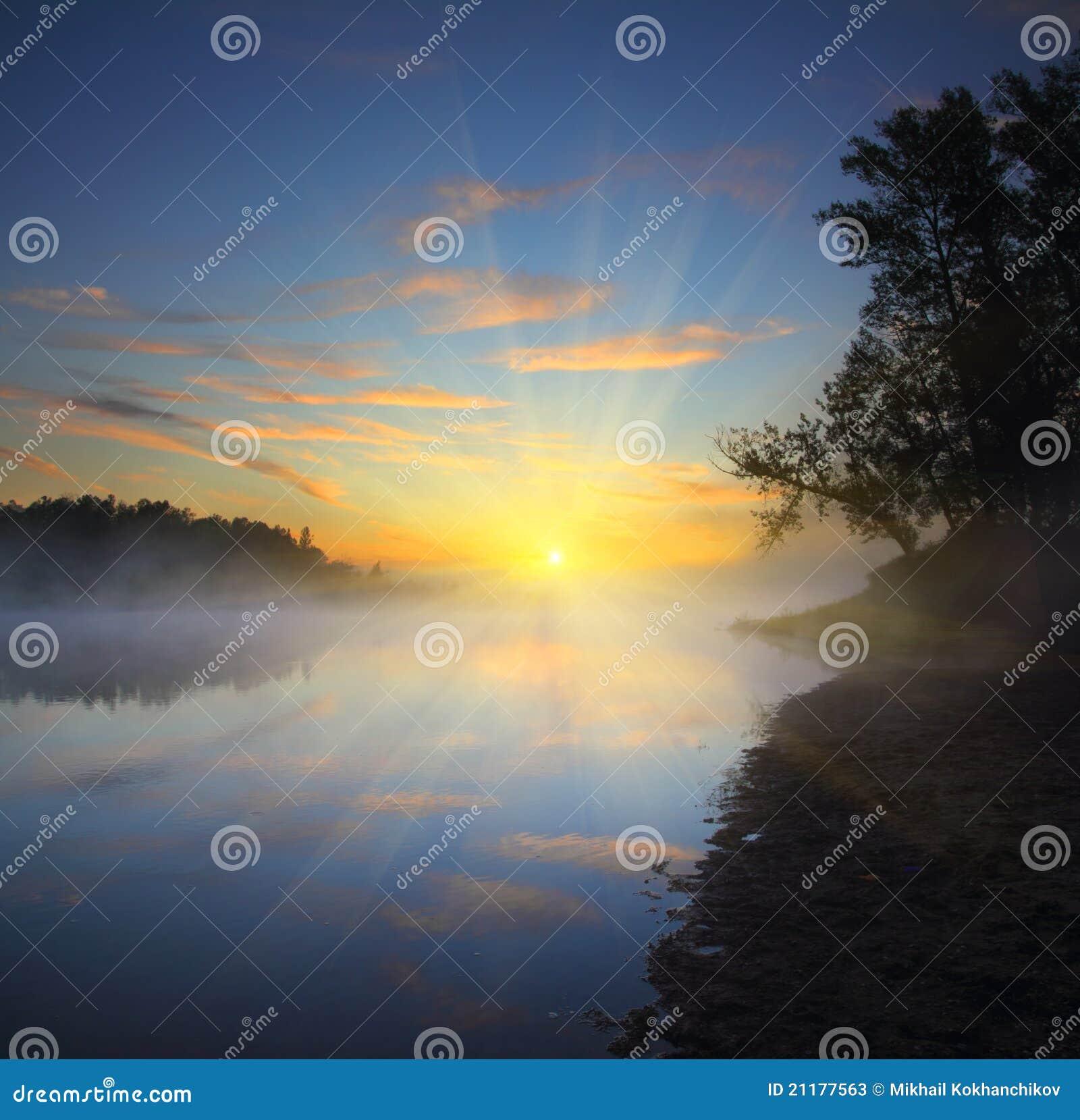 Beautiful fog sunrise on river