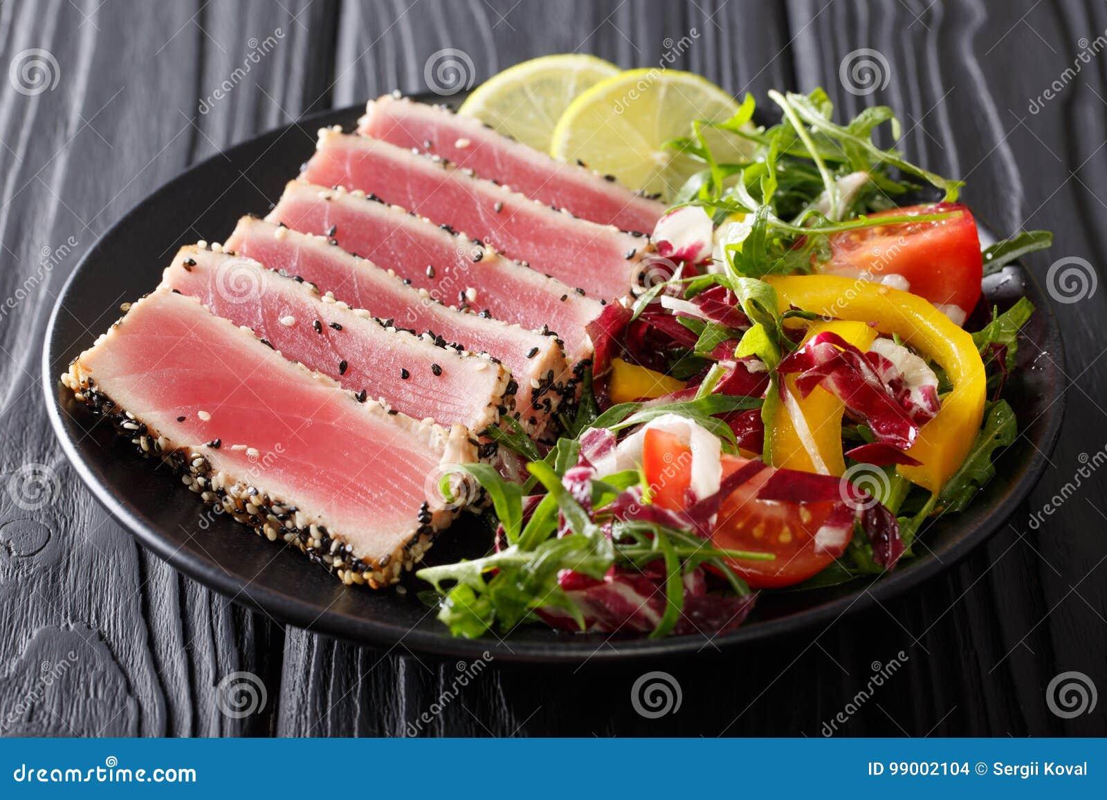 Beautiful food: steak tuna in sesame, lime and fresh salad close