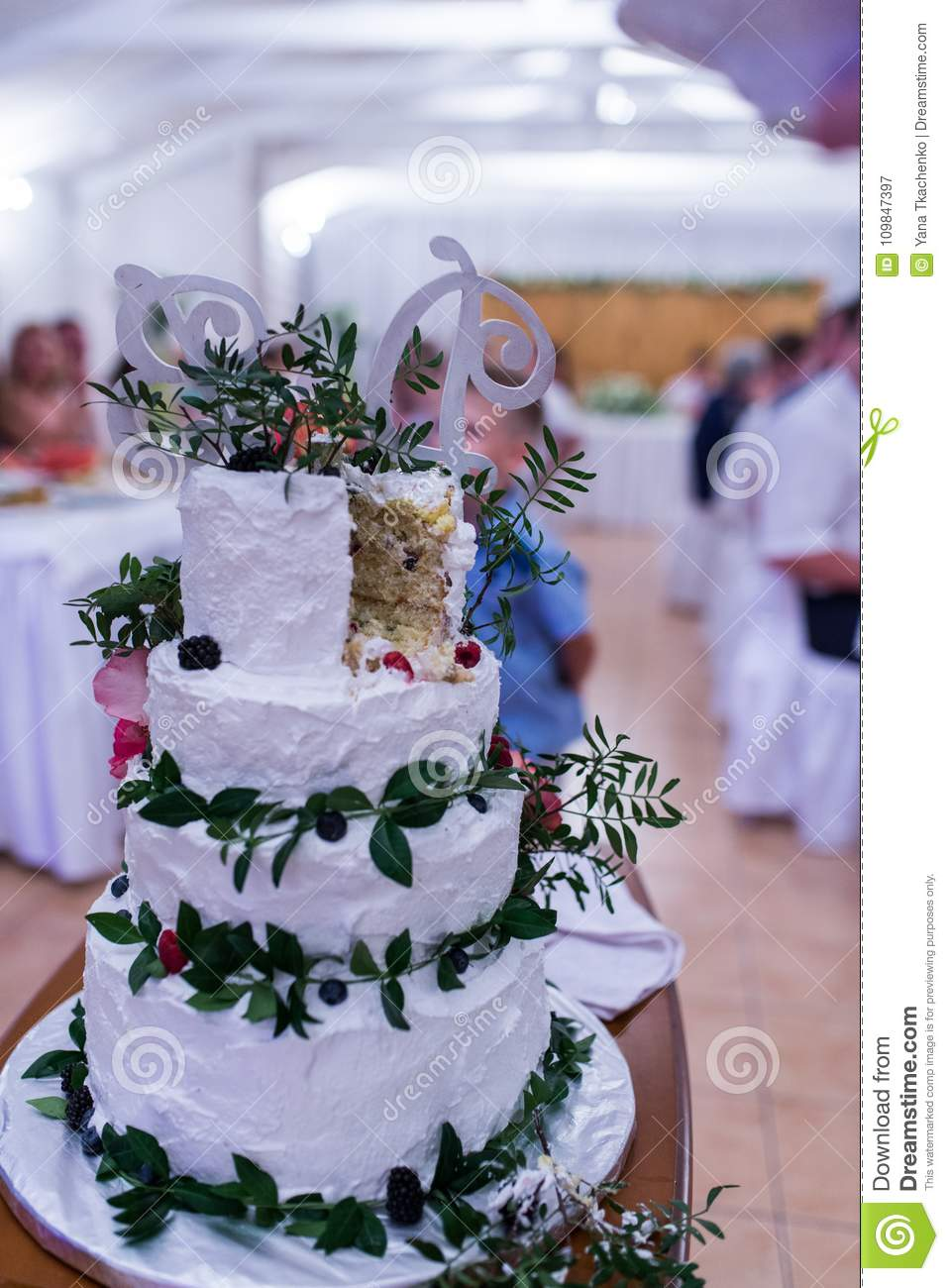 Beautiful Four Tiered White Wedding Cake With Pink Flowers And