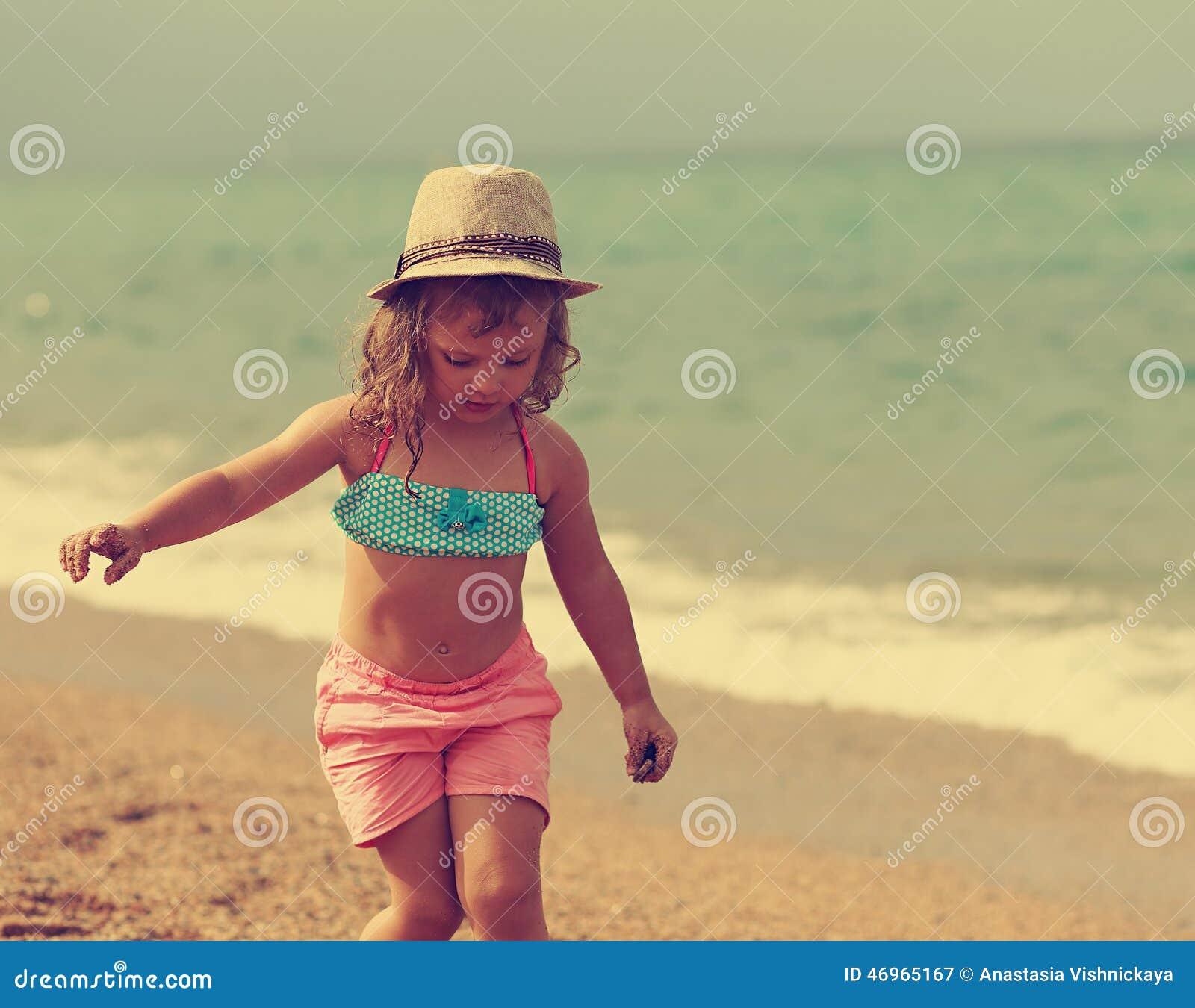beautiful free kid girl walking in the beach instagram
