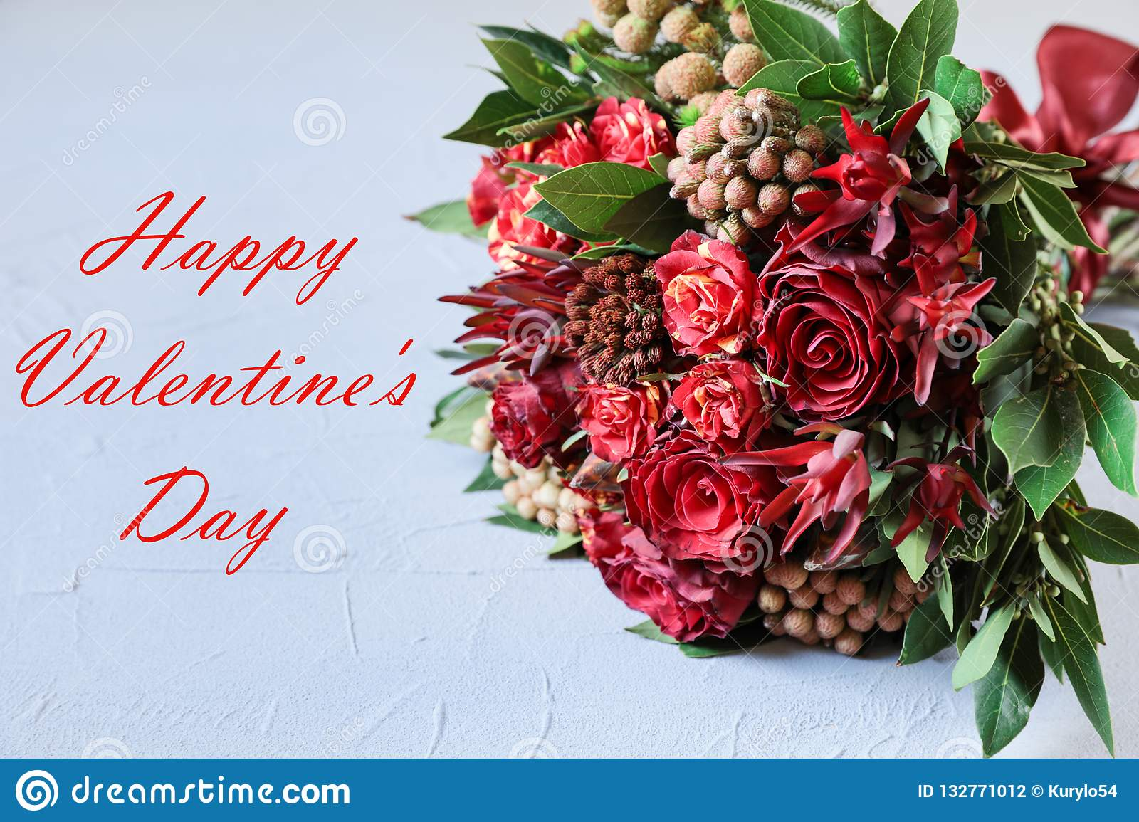 Beautiful fresh flower arrangement of red roses and text wish, Valentines day greeting card concept.