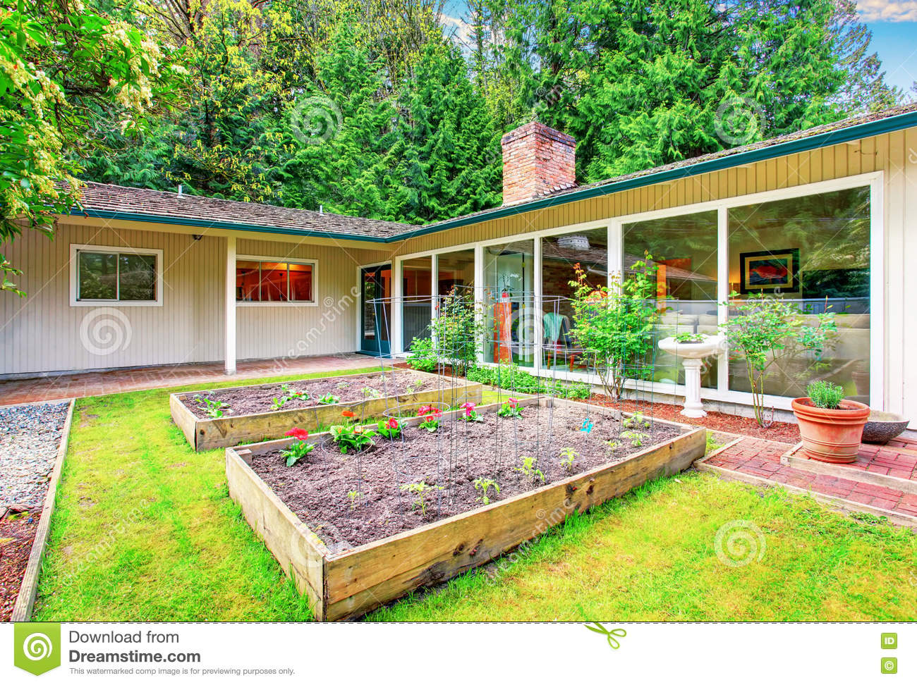 Vegetable garden with covered walkways - Royalty Free Stock Photo