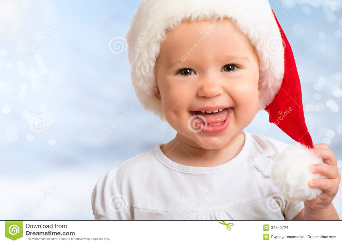 3c8df5a5a13 Beautiful Funny Baby In A Christmas Hat On Blue Stock Photo - Image ...