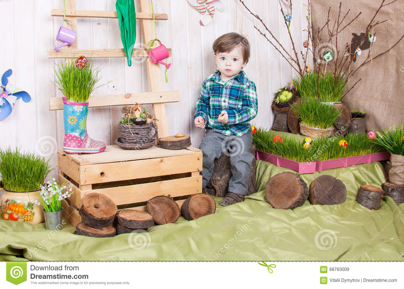 Beautiful funny little boy playing among easter spring scenery.