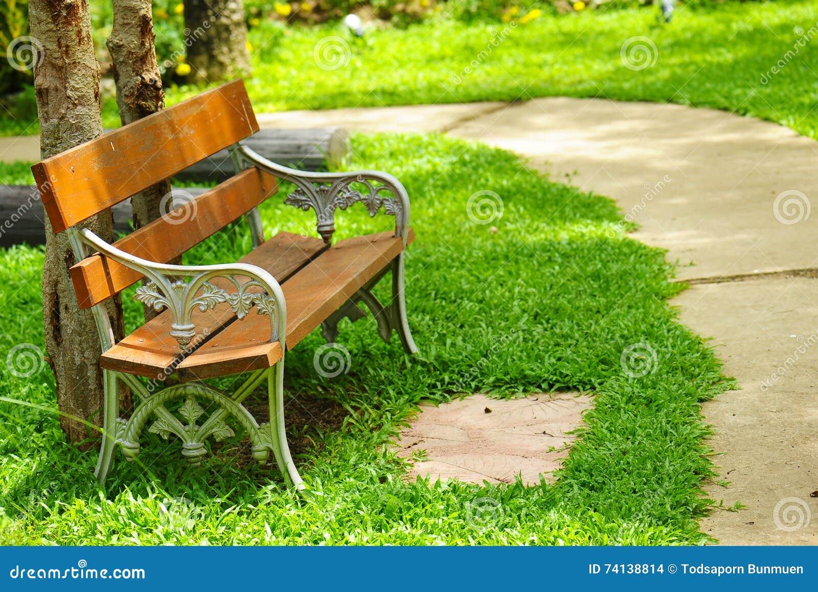 beautiful garden chair in the garden stock photo - image: 74138814
