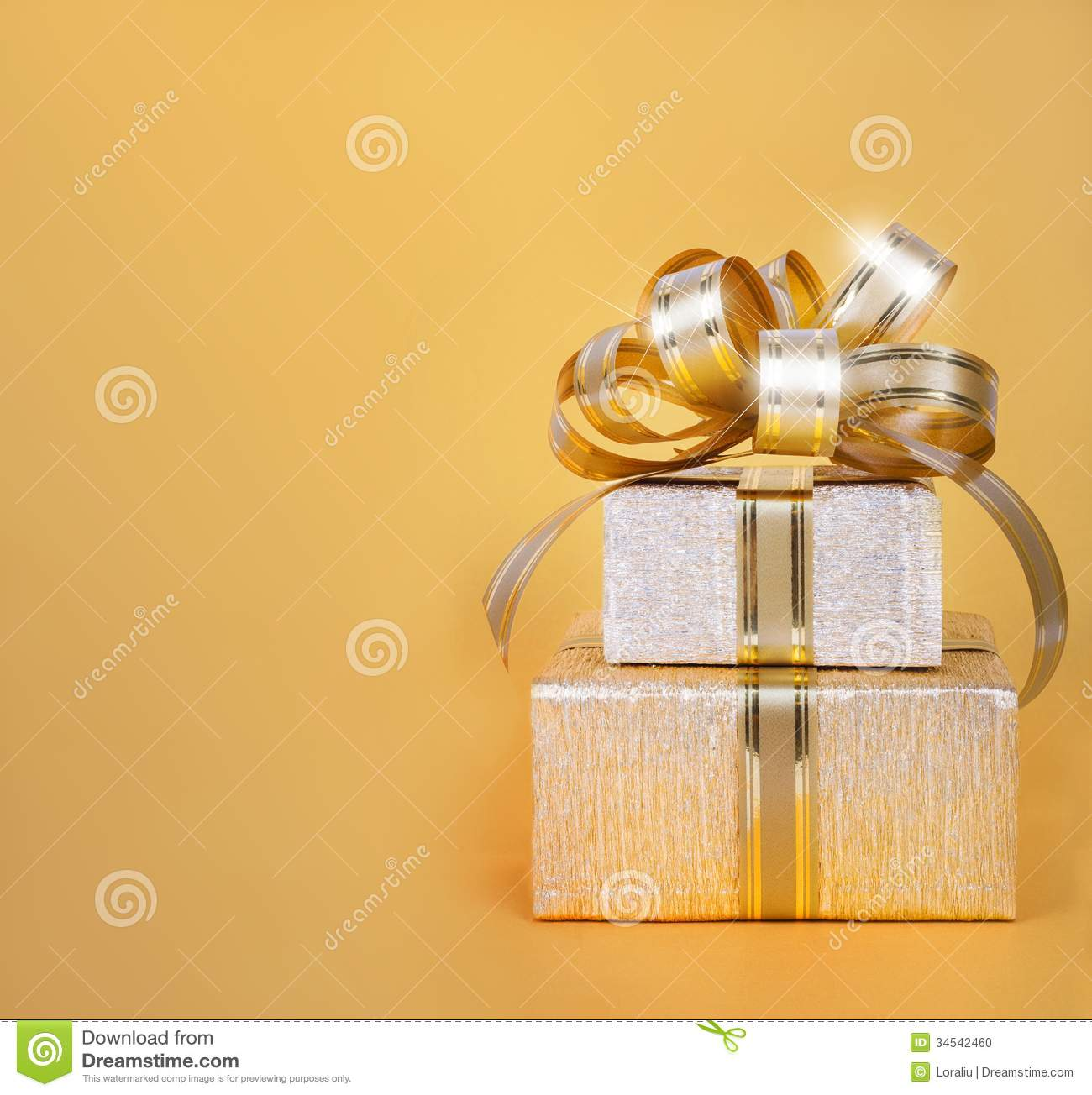 Beautiful gift box in gold wrapping paper stock photo - How to make beautiful gift box ...
